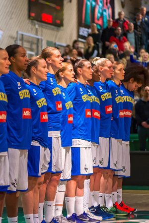 anthem: SODERTALJE, SWEDEN - NOV 21, 2015: Swedish team during the national anthem during the European Qualifier game between Sweden and Spain. Editorial