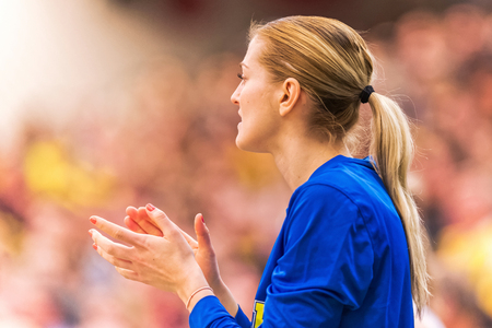 substitute: SODERTALJE, SWEDEN - NOV 21, 2015: Swedish substitute player clapping hands at the Women European Basketball Qualifier game between Sweden and Spain at Taljehallen.