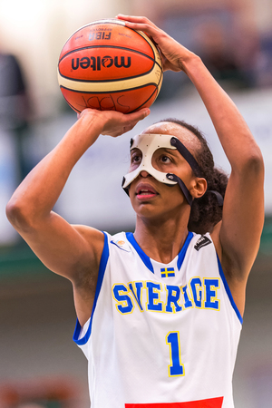 facemask: SODERTALJE, SWEDEN - NOV 21, 2015: Penelty shot by Farhiya Abdi  in the Women European Basketball Qualifier game between Sweden and Spain at Taljehallen.