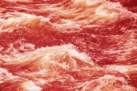 raging: Raging water making waves. Red filter applied Stock Photo