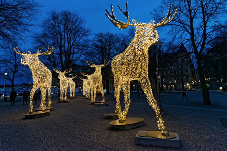 stock photo stockholm sweden dec 27 2015 group of christmas moose made of led light at nybrokajen