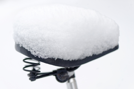 saddle: Bike saddle covered in snow. Sweden Stock Photo