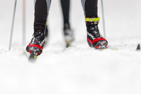 nordic ski: STOCKHOLM, SWEDEN - JAN 24, 2016: Closeup of ski runners fet and legs at Ski Marathon in nordic skiing classic style.