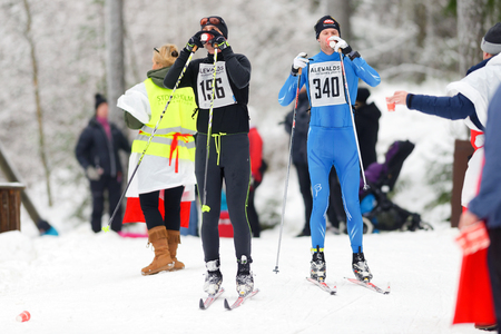 nordic ski: STOCKHOLM, SWEDEN - JAN 24, 2016: Skiiers taking refreshing drinks at the Ski Marathon in nordic skiing classic style.