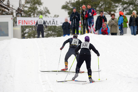 cross country: STOCKHOLM, SWEDEN - JAN 24, 2016: The climb to the finnish line at the Ski Marathon in cross country skiing.