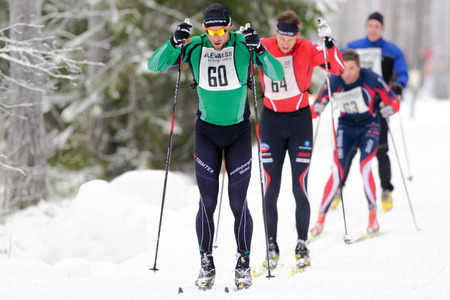 leading: STOCKHOLM, SWEDEN - JAN 24, 2016: Leading group at the Ski Marathon in nordic skiing classic style.