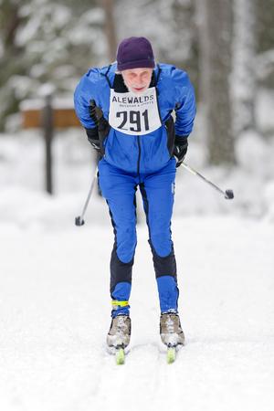 nordic ski: STOCKHOLM, SWEDEN - JAN 24, 2016: Older man at the event Ski Marathon in nordic skiing classic style.