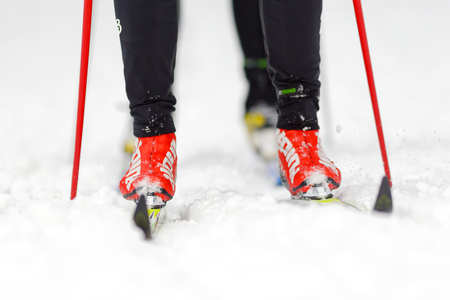 STOCKHOLM, SWEDEN - JAN 24, 2016: Closeup of ski runners fet and legs at Ski Marathon in nordic skiing classic style.