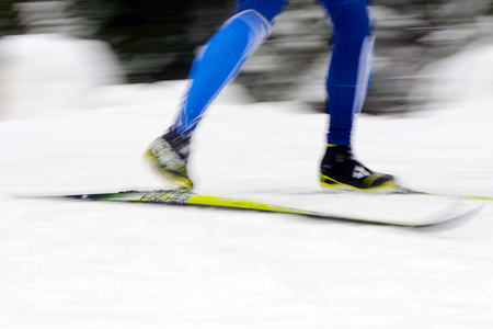 nordic ski: STOCKHOLM, SWEDEN - JAN 24, 2016: Colorful skier in motion blur. Ski Marathon in nordic skiing classic style.