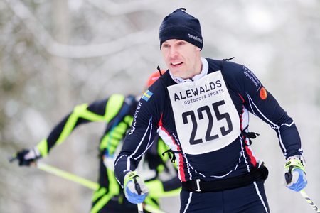 nordic ski: STOCKHOLM, SWEDEN - JAN 24, 2016: Athletes in the forest at the Ski Marathon in nordic skiing classic style.