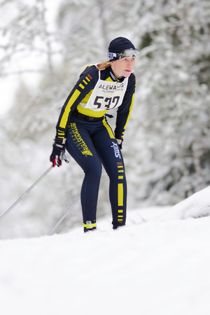 marken: STOCKHOLM, SWEDEN - JAN 24, 2016: Female skier at the event Ski Marathon in nordic skiing classic style.