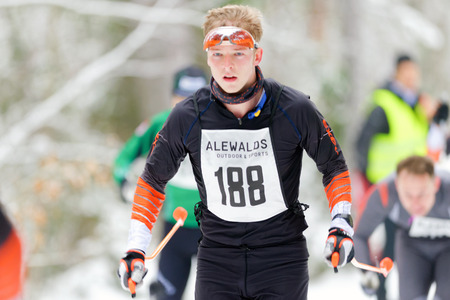 nordic ski: STOCKHOLM, SWEDEN - JAN 24, 2016: Man with ski glasses at Ski Marathon in nordic skiing classic style.