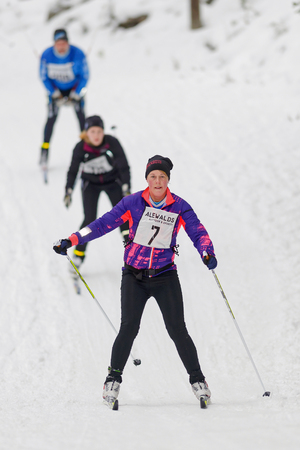 nordic ski: STOCKHOLM, SWEDEN - JAN 24, 2016: Skiers downhill at the event Ski Marathon in nordic skiing classic style. Editorial