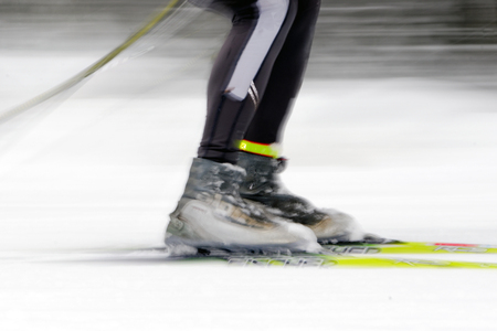 nordic ski: STOCKHOLM, SWEDEN - JAN 24, 2016: Colorful skiing shoes in motion blur. Ski Marathon in nordic skiing classic style.
