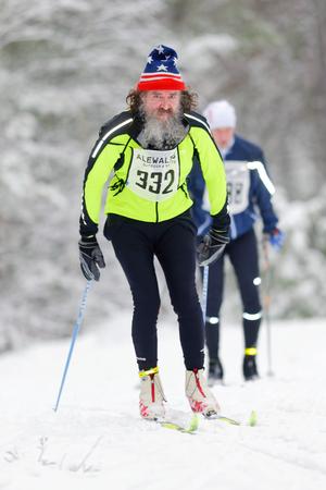 nordic ski: STOCKHOLM, SWEDEN - JAN 24, 2016: Bearded man at the event Ski Marathon in nordic skiing classic style.