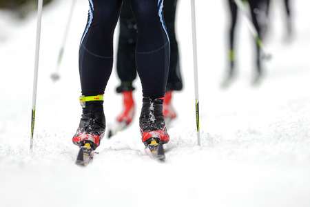 wintersports: STOCKHOLM, SWEDEN - JAN 24, 2016: Detail of legs and feet at the Ski Marathon in crosscountry skiing classic style.