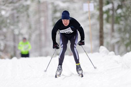 nordic ski: STOCKHOLM, SWEDEN - JAN 24, 2016: Focused man at the Ski Marathon in nordic skiing classic style.