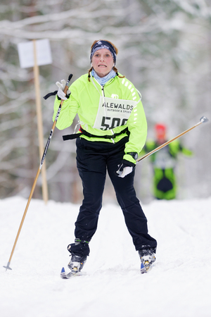 nordic ski: STOCKHOLM, SWEDEN - JAN 24, 2016: Exhausted woman at the Ski Marathon in nordic skiing classic style.