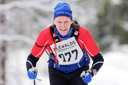 nordic ski: STOCKHOLM, SWEDEN - JAN 24, 2016: Closeup of male skier at the Ski Marathon in nordic skiing classic style. Editorial