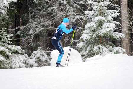 sideview: STOCKHOLM, SWEDEN - JAN 24, 2016: Sideview of a ski runner at the event Ski Marathon in nordic skiing classic style. Editorial