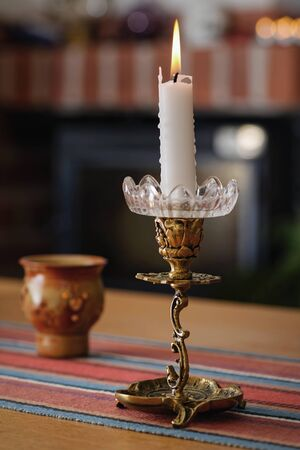 Candellight on a table in a cozy enviroment. Sweden