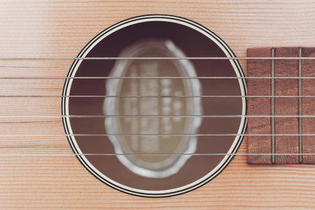 accoustic: Closeup of an old accoustic guitar. Desaturated colors Stock Photo