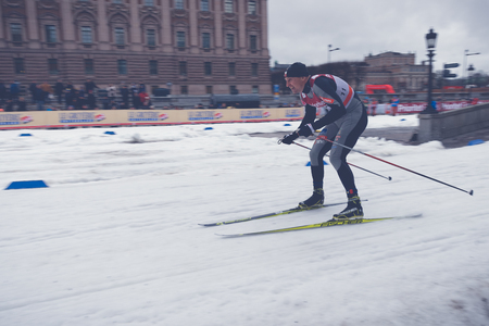 historic world event: STOCKHOLM, SWEDEN - FEB 11, 2016: Cross country skier at the FIS World Cup Sprint event at the Royal Palace Sprint in Stockholm.