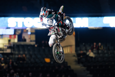 solna: SOLNA, SWEDEN - MARCH 4, 2016: Acrobatic jump from Brice Izzo (FRA) at the Night of the jumps in Stockholm, Friends arena
