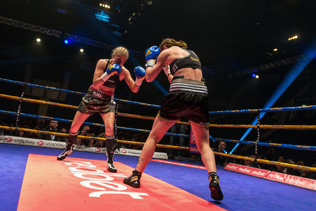 lightweight: STOCKHOLM, SWEDEN - APRIL 23, 2016: Nordic fight night boxing between Klara Svensson (SWE) and Lucia Morelli (GER) Super Lightweight. Klara Svensson won Editorial