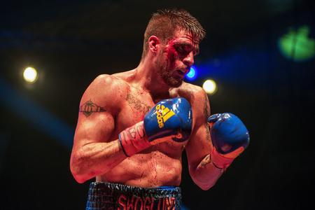 rsa: STOCKHOLM, SWEDEN - APRIL 23, 2016: IBO Title boxing match between Erik Skoglund (SWE) and Ryno Liebenberg (RSA) Light heavyweight. Erik Skoglund won
