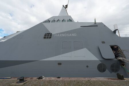 embarked: STOCKHOLM, SWEDEN - APRIL 23, 2016: Two military stealth corvettes in the Visby class embarked in Stockholm. HMS Harnosand and Nykoping.