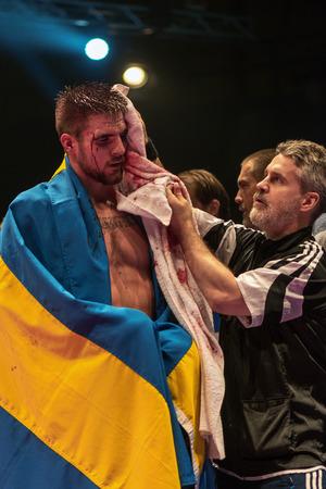 boxing match: STOCKHOLM, SWEDEN - APRIL 23, 2016: IBO Title boxing match between Erik Skoglund (SWE) and Ryno Liebenberg (RSA) Light heavyweight. Erik Skoglund won