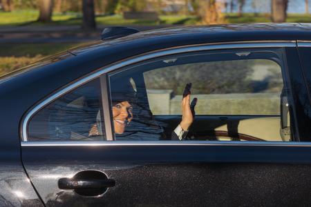 gustaf: StOCKHOLM, SWEDEN - APRIL 29, 2016: Celebration of Carl XVI Gustaf of Sweden on his 70ths birthday, princess Vivtoria waving happy ina car.