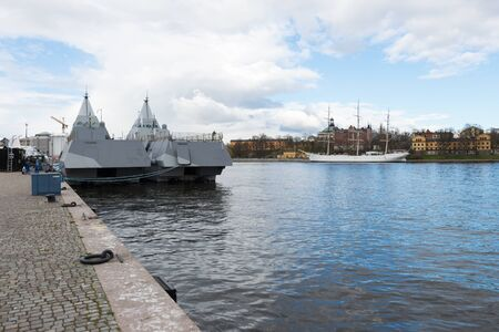 STOCKHOLM, SWEDEN - APRIL 23, 2016: Two military stealth corvettes in the Visby class embarked in Stockholm. HMS Harnosand and Nykoping.