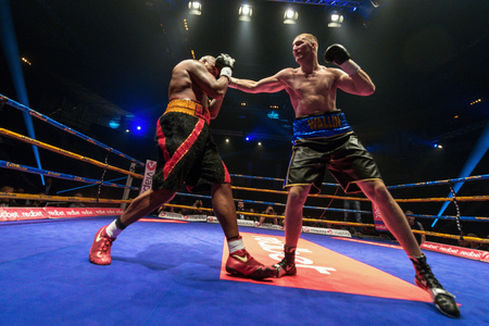 the heavyweight: STOCKHOLM, SWEDEN - APRIL 23, 2016: Nordic fight night boxing between Otto Wallin (SWE) and Irineu Beato Costa Jr (BRA) Heavyweight. Otto Wallin won KO