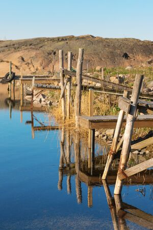footbridges: Small harbour in a bay with wooden footbridges. Grisslehamn, Sweden