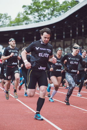 obstacle course: STOCKHOLM, SWEDEN - MAY 14, 2016 Start of the Tough Viking obstacle course in Stockholm Stadion with the first obstacle the American football players.