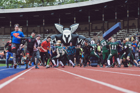 obstacle: STOCKHOLM, SWEDEN - MAY 14, 2016 Start of the Tough Viking obstacle course in Stockholm Stadion with the first obstacle the American football players.