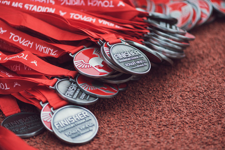 obstacle course: STOCKHOLM, SWEDEN - MAY 14, 2016 Medals of the Tough Viking obstacle course in Stockholm Stadion,