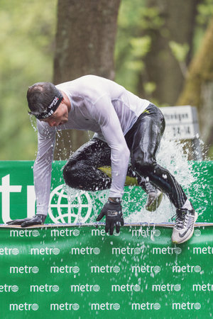 sportsmanship: STOCKHOLM, SWEDEN - MAY 14, 2016 Tough Viking obstacle course in Stockholm Stadion with the ice cold water obstacle.