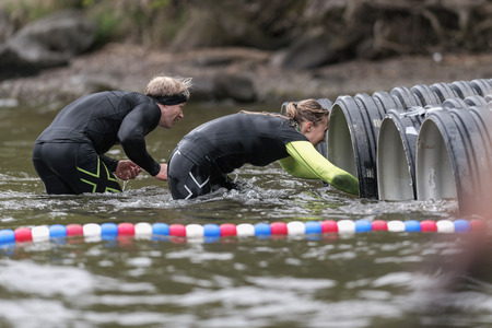 floaters: STOCKHOLM, SWEDEN - MAY 14, 2016 Tough Viking obstacle course around Stockholm Stadion with the water and tube obstacle. Editorial