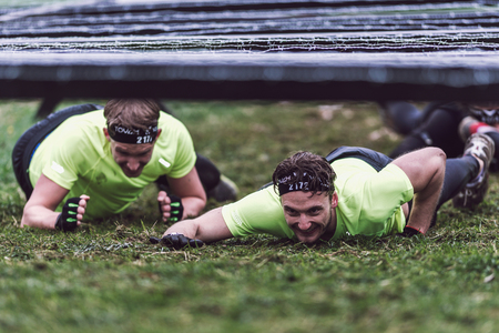 STOCKHOLM, SWEDEN - MAY 14, 2016 Tough Viking obstacle course around Stockholm Stadion with the barbed wire obstacle. Editorial