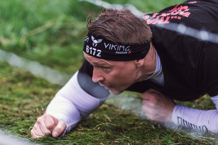 obstacle course: STOCKHOLM, SWEDEN - MAY 14, 2016 Tough Viking obstacle course around Stockholm Stadion with the barbed wire obstacle. Editorial