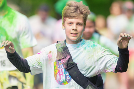 STOCKHOLM, SWEDEN - MAY 22, 2016: Boy between the color stations at Color Run Tropicolor world tour in Stockholm.