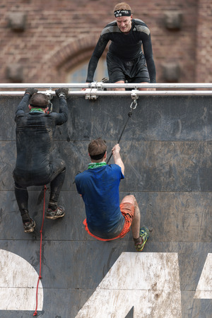 tough: STOCKHOLM, SWEDEN - MAY 14, 2016 Climbing at Tough Viking obstacle course around Stockholm Stadion. Editorial