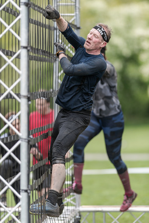 tough: STOCKHOLM, SWEDEN - MAY 14, 2016 Net climb at Tough Viking obstacle course around Stockholm Stadion. Editorial
