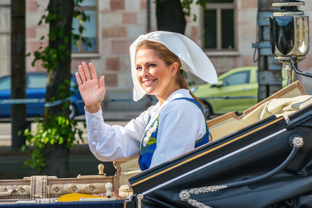 the madeleine: STOCKHOLM, SWEDEN - JUNE 6, 2016: Royal cortege with Princess Madeleine waving. Swedish Royalty on the way to Skansen.