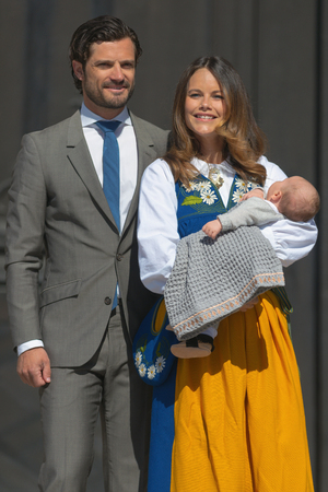 prince: STOCKHOLM, SWEDEN - JUNE 6, 2016: Prince Carl Philip and Princess Sofia with their newborn Prince Alexander invites the public to the royal castle during the national celebration day, 6th of June.