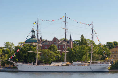 chapman: STOCKHOLM, SWEDEN - JUNE 6, 2016: The Af Chapman the great hostel ship in the Stockholm City. During the national day with flags