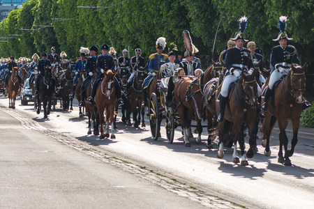 STOCKHOLM, SWEDEN - JUNE 6, 2016: Royal cortege with the King and Queen of Sweden with mounted guards. Swedish Royalty on the way to Skansen.